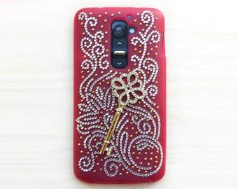 LG G2 smartphone case. Unique. Handmade. Silver flower swirl spiral rhinestone design. Gold key charm. Red, matte, durable.