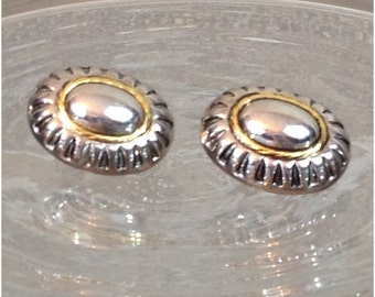 Shiny silver tone oval clip earrings with gold accents