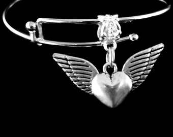 winged heart charm bracelet winged charm bracelet The heart that soars with angel wings the soaring heart