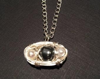 Pearl trio bird nest necklace