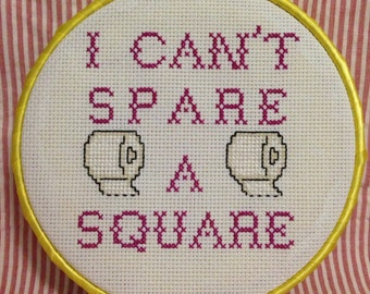 Framed hoop Seinfeld quote cross stitch