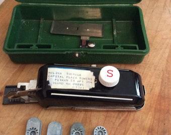 Vintage Singer Buttonholer in original case with templates.
