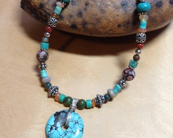 Semi precious gemstone bead necklace with turquoise, magnesite, jade, carnelian, garnet and sterling silver