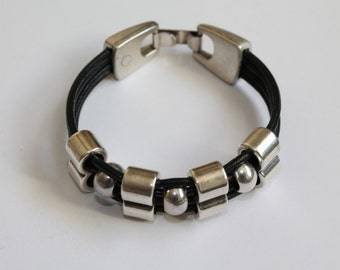 ON SALE Women s black leather bracelet with a double slider-spacer
