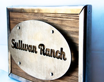 Stylish rustic sign with LED diodes from polished metal and reclaimed wood with a metal frame. Wooden sign / Rustic Sign in rustic style
