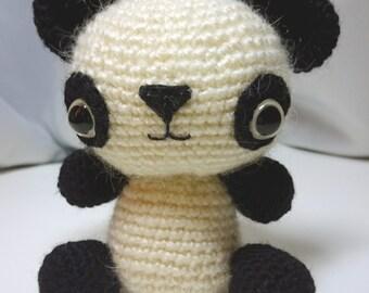 Little crocheted amigurumi, crochet handmade toy, panda