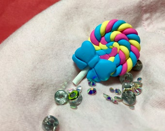 Blue, pink, & yellow polymer clay (soft) lollipop ring