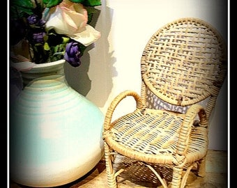 Vintage decorative dolls chair of woven reeds.