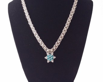 Blue crystal snowflake pendant on a hand woven helm weave chainmaille necklace