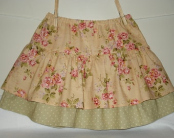 Beautiful floral girls tier skirt with contrast dots.