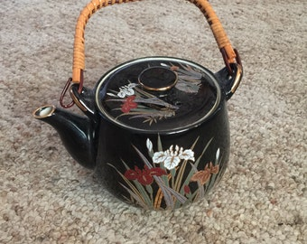Vintage oriental teapot with bamboo woven handle