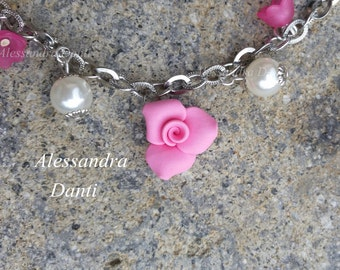 Pink bracelet with flowers and leaves.