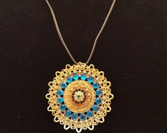 Leather necklace with gold crystal pendant