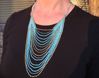 Bue and gold statement necklace.