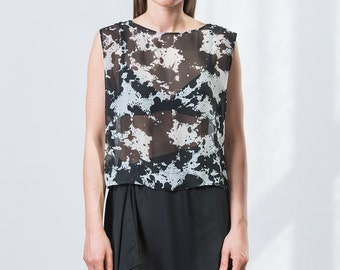 Black and white transparent top without sleeves