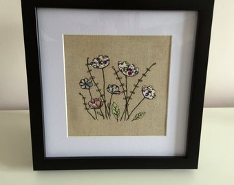 Wildflower free motion machine embroidery picture. Floral art. Summer meadow stitched picture
