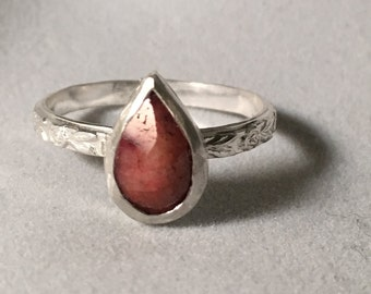 Faceted Ruby with Decorative Band