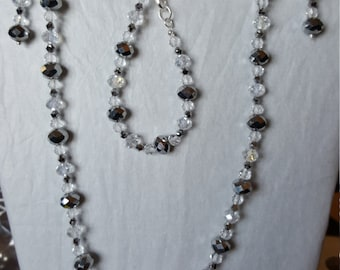 Silver and clear jewelry ensemble - necklace, bracelet, and earrings