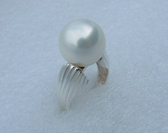very large silver and pearl ring