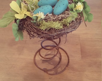 Bird Nest on Rusty Spring