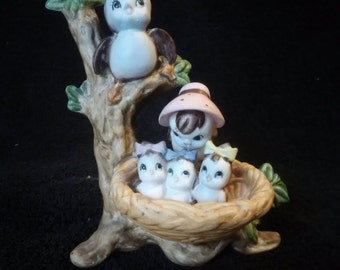 Vintage figurine bird family in tree and nest