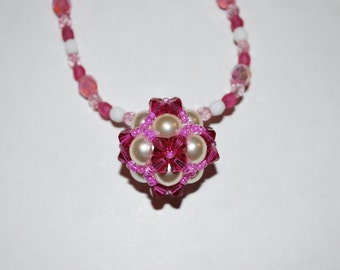 Pink ball necklace