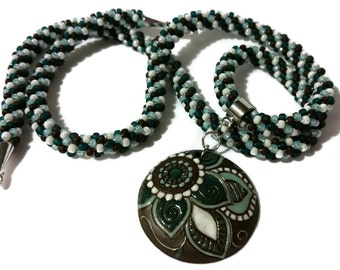 Blue Paisley Flower Pendant On A Kumihimo Necklace