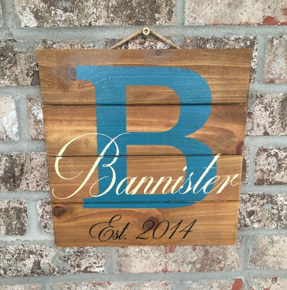hand painted personalized wood sign with family initial and