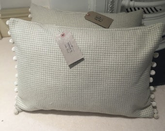 Beautiful cushion with pompoms