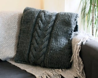 Grey cable hand knit cushion