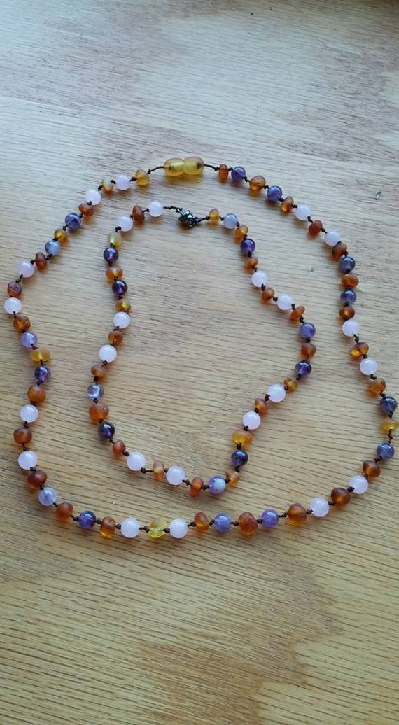 Emelia. Raw Cognac Baltic Amber, Rose Quarts, Amethyst. Individually knotted beads on Brown string with Amber Screw Clasp or Magnetic clasp.