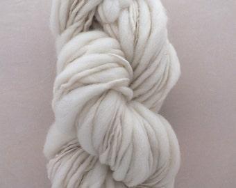 Hand spun thick and thin yarn, undyed natural organic Merino wool slub