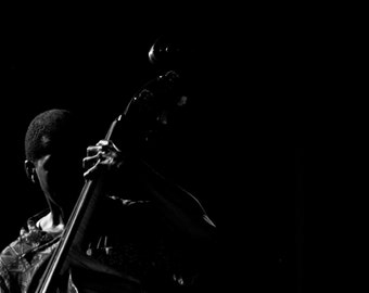 Black & White Bass Player Profile Photograph