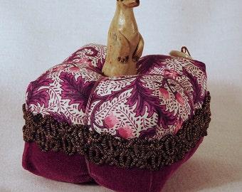 Little Stoneware Meerkat Pincushion- stoneware meerkat on an antique fabric tuffet