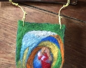 Needle felted wool tapestry with breast-feeding mother in red/pink