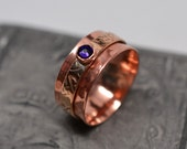 3/8 inch wide textured bronze & copper spinner ring with Swarovski crystal stone