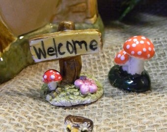 Fairy or gnome Garden Miniature Sign  . All Hand made ceramic Glazed Red Mushroom and daisy accents