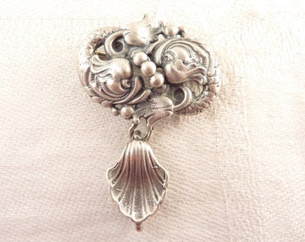 Ornate Pair of Antique Sterling Dolphins Brooch with Dangling Shell