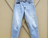 vintage Levi's 550 Light Wash Relaxed Fit Denim Jeans / made in the U.S.A.