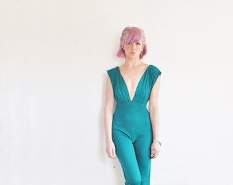 one piece teal green jumpsuit . wide or skinny shoulders, oooh .extra small.xs
