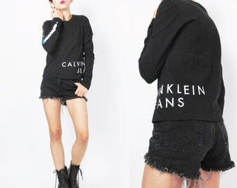 90s Calvin Klein Jeans Tshirt CK Logo Long Sleeve Tshirt Striped Sleeves Black Cotton Tee Fitted Womens Graphic Sporty Crop Top (S/M)