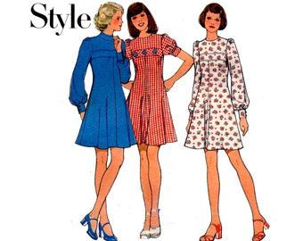 Style 4441 Womens Puff Sleeved Fit & Flare Dress with Inset band 70s Vintage Sewing Pattern Size 10 Bust 32 1/2 inches UNCUT Factory Folded