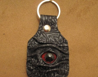 Grichels leather keychain - black and silver tapestry with red carousel horse eye