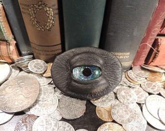 Dragon eye Brooch (Black leather with Sparkling Blue  Eye)