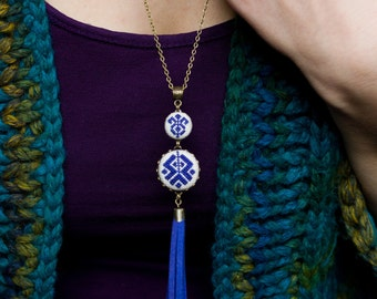 Ethnic inspired necklace with dark blue cross stitch and suede tassel n065