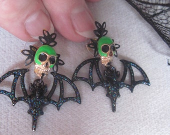 Green Skulls and Iridescent Black Bat Halloween Earrings