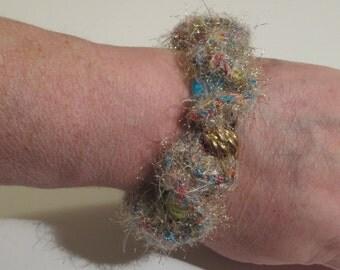 Fuzzy gold crocheted beaded bracelet
