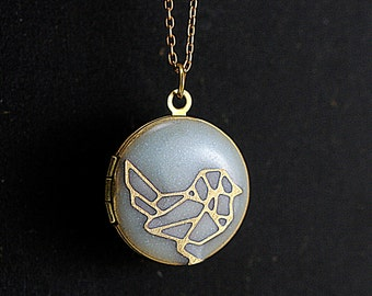 Small sparrow locket necklace. Pale blue resin with embedded origami sparrow. Delicate brass gold locket necklace.