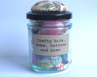 Crafty bits and bobs in a little pincushion jar