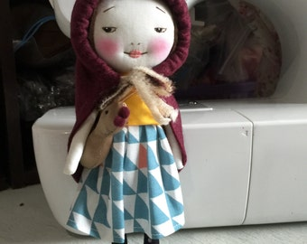 Handmade smiling red riding hood with golden goose